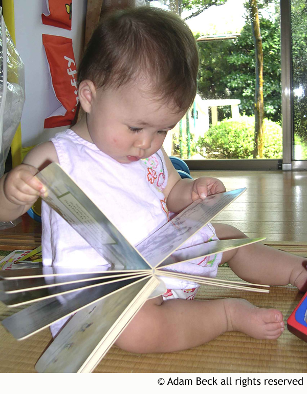 baby reading a bilingual book