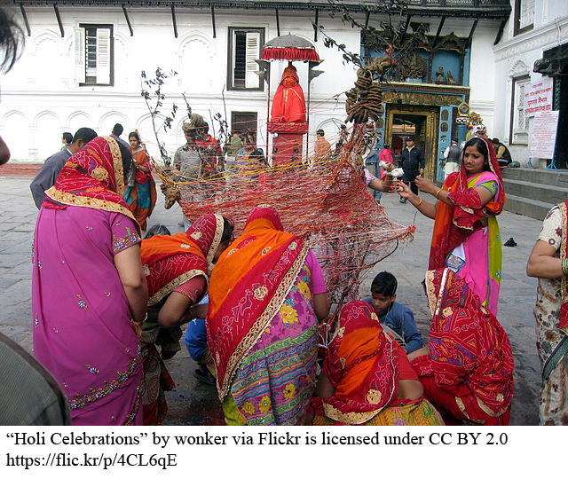 women preparing for holi celebration