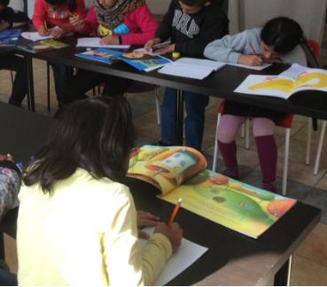refugee children using Language Lizard books