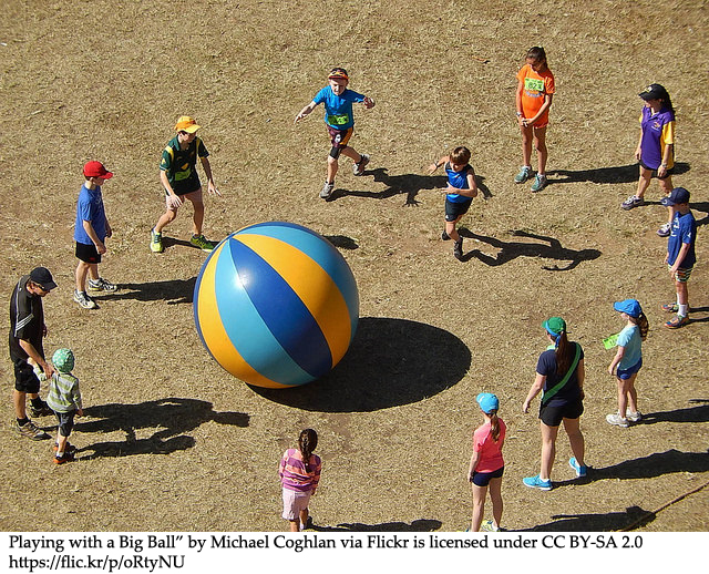 Kids playing with a large ball